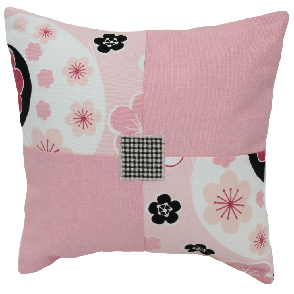 pink black and white patchwork pillow