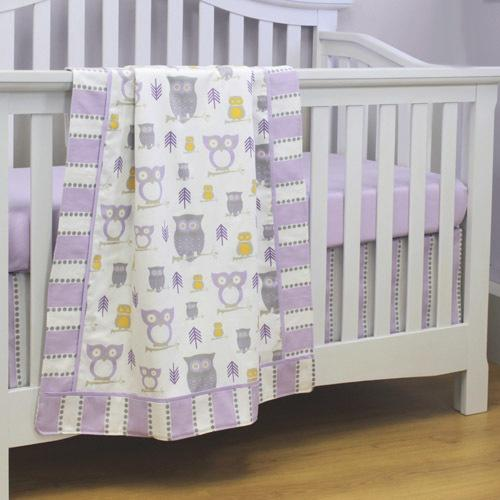 lilac grey white and yellow owl patterned baby blanket on a white crib