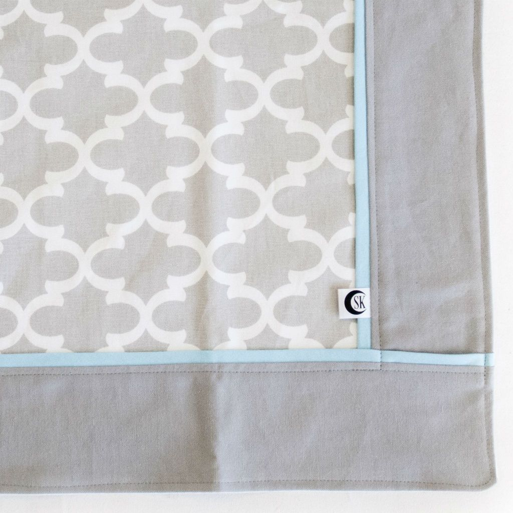grey and white trellis baby blanket with blue trim
