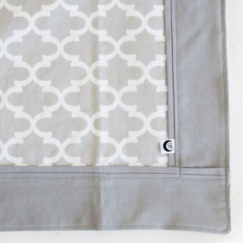 grey and white trellis baby blanket with grey trim