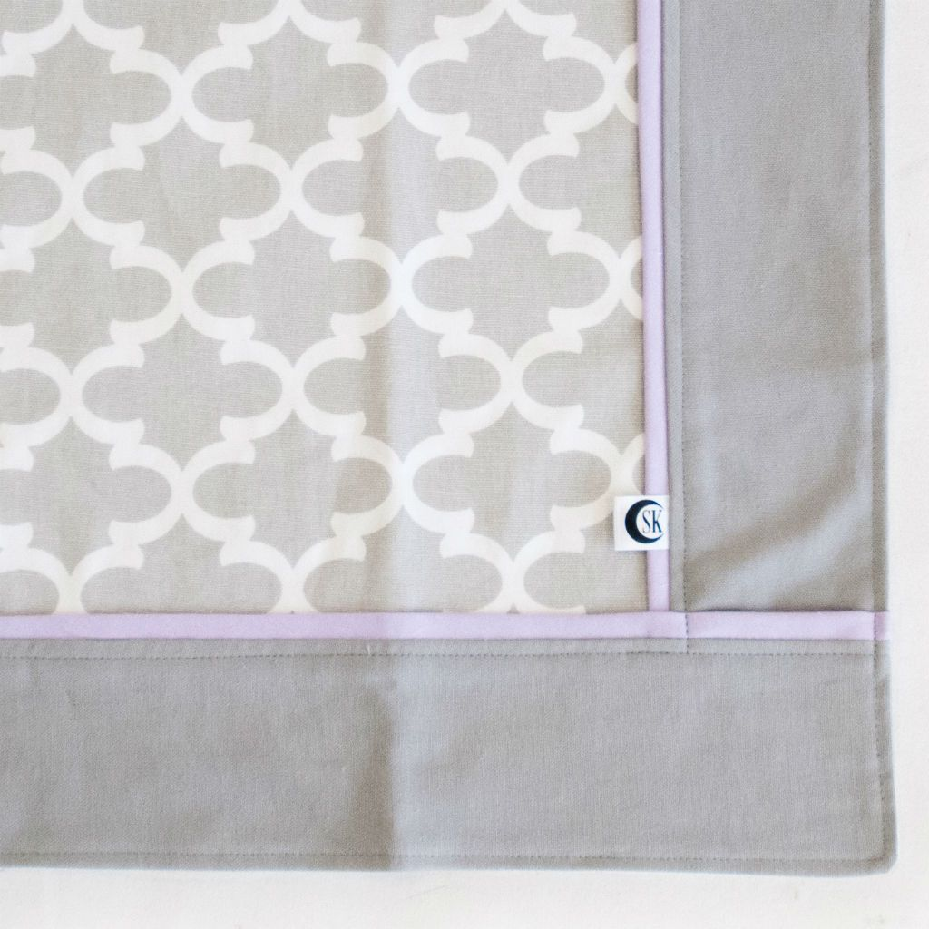 grey and white trellis baby blanket with lilac trim