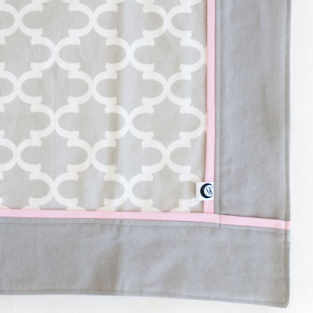 grey and white trellis baby blanket with pink trim