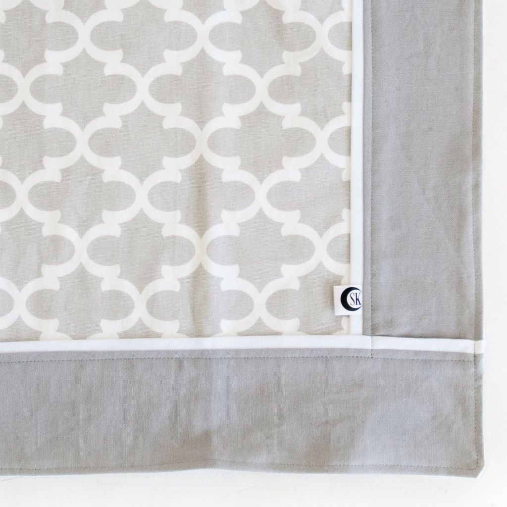 grey and white trellis baby blanket with white trim