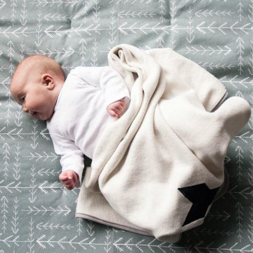cute baby on sage green arrowhead play blanket with organic baby blanket