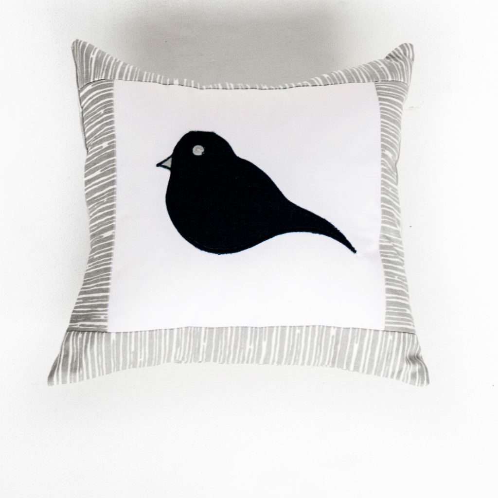 woodland bark decor pillow with navy applique bird