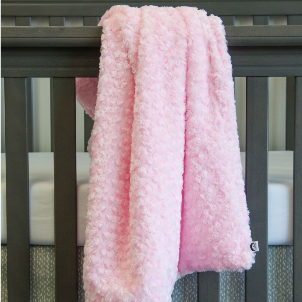 swirl chenille minky baby blanket in pink on grey crib