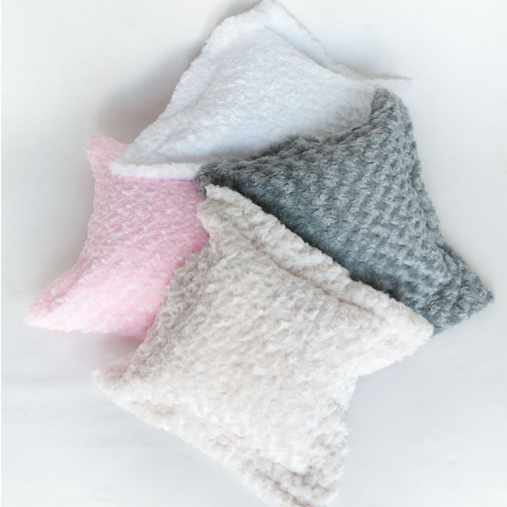 swirl chenille minky flange pillows in pink, white, grey, ivory on white ground