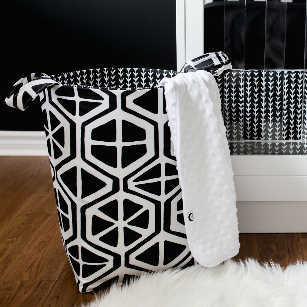 black and white hexagon pattern basket with white blanket