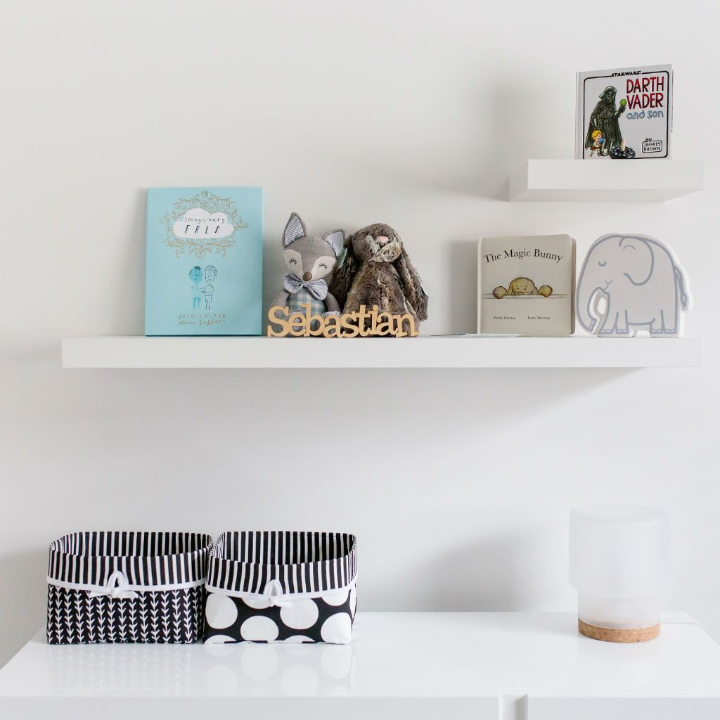 shelves with knick knacks and black and white baskets