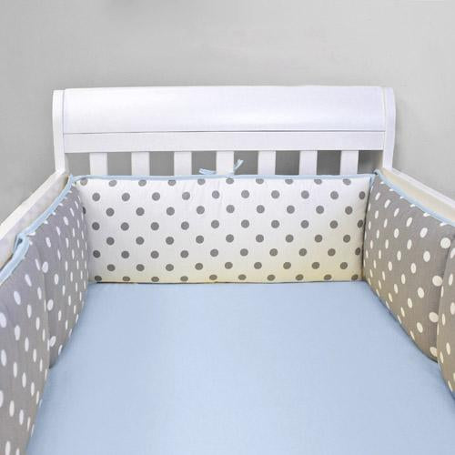 polka dot grey and white bumper pads on white crib