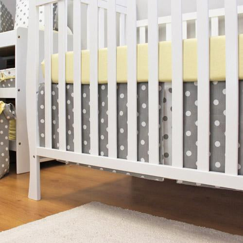 polka dot grey and white crib skirt with sheet, on white crib