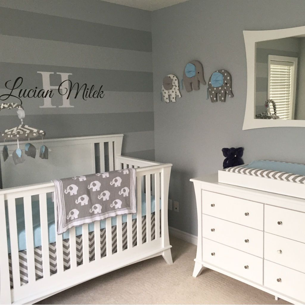 grey and white baby nursery with elephant wall art, crib skirt white crib and dresser
