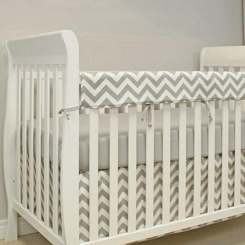 grey and white zigzag rail protector, grey crib sheet, crib skirt on white crib
