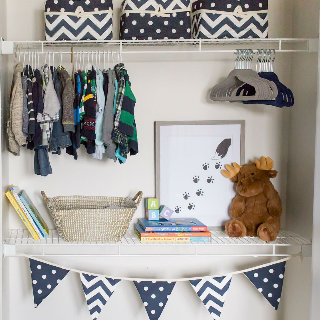 navy and white varsity flags and baskets in closet with stuffed moose