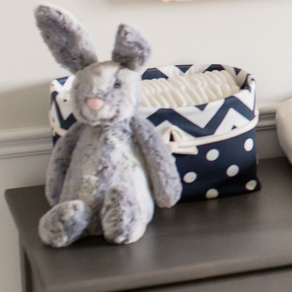navy and white dot basket on grey dresser with grey bunny