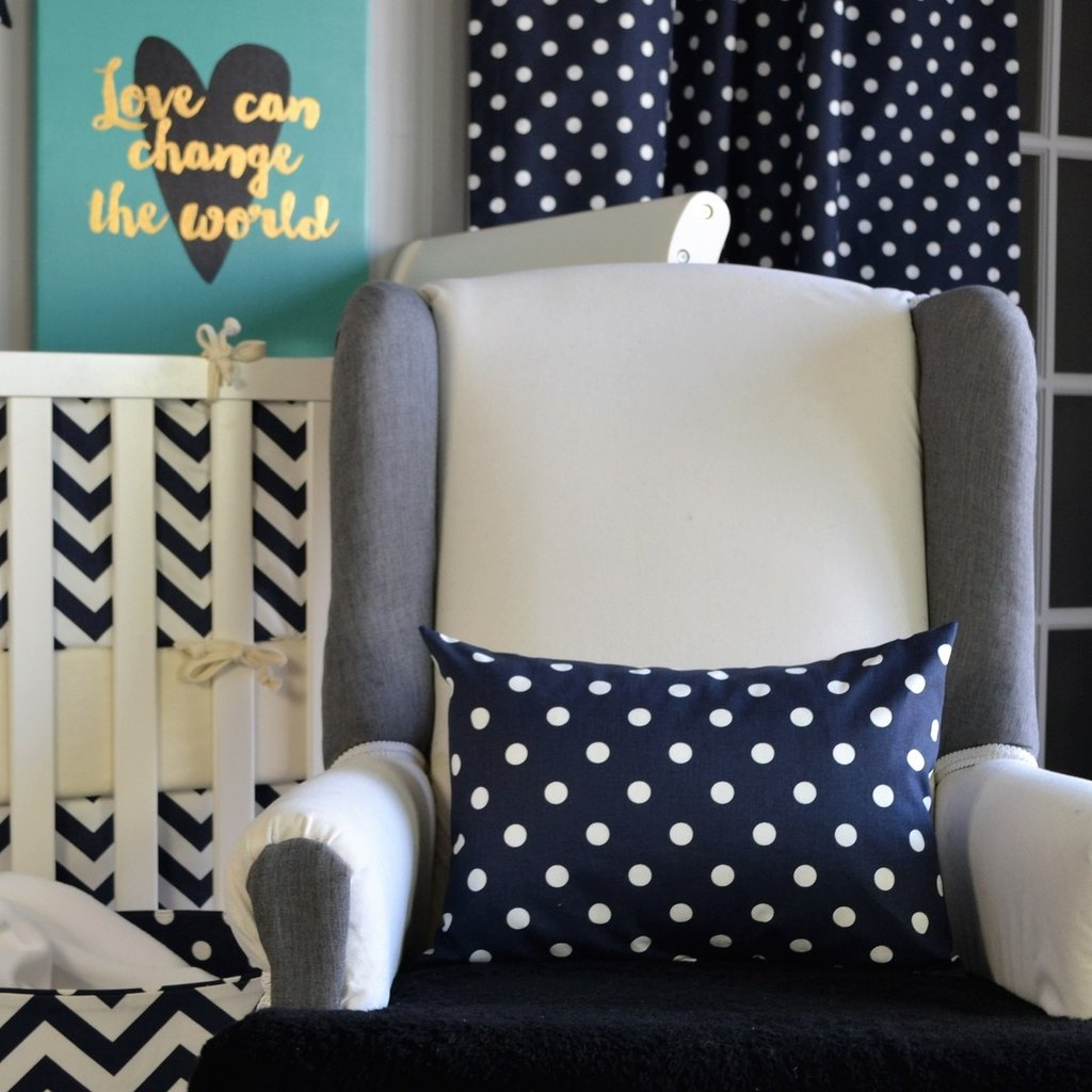 navy and white dot lumbar pillow on white chair