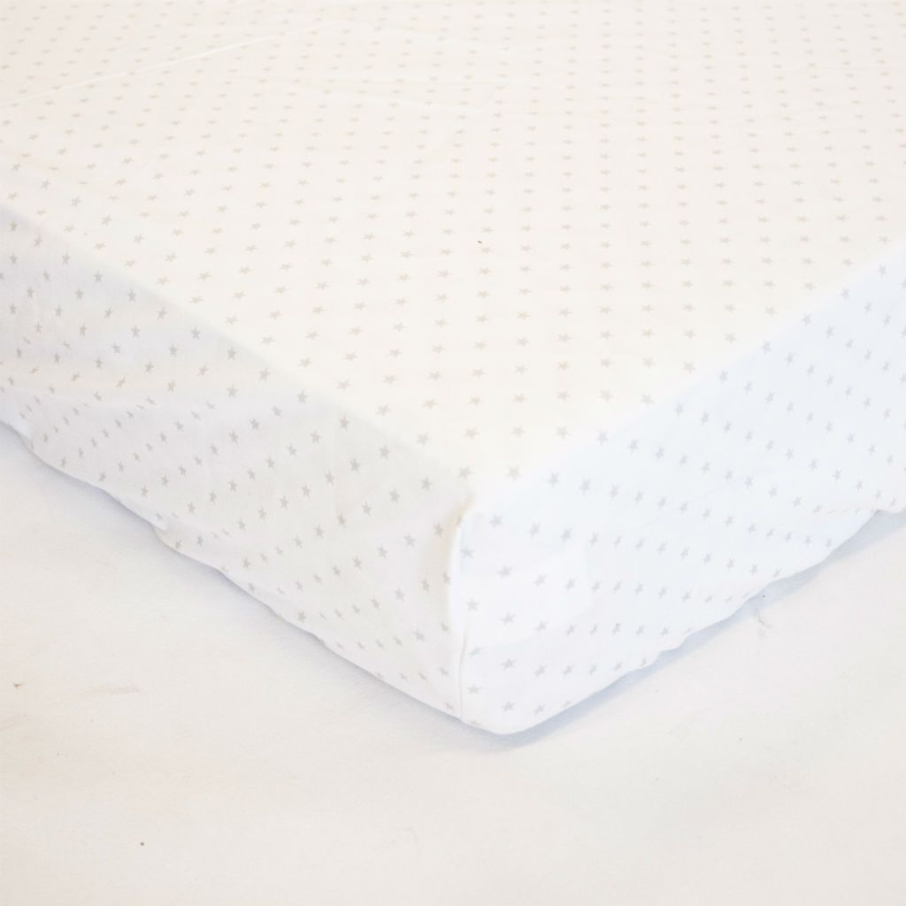 white crib sheet with mini stars over mattress