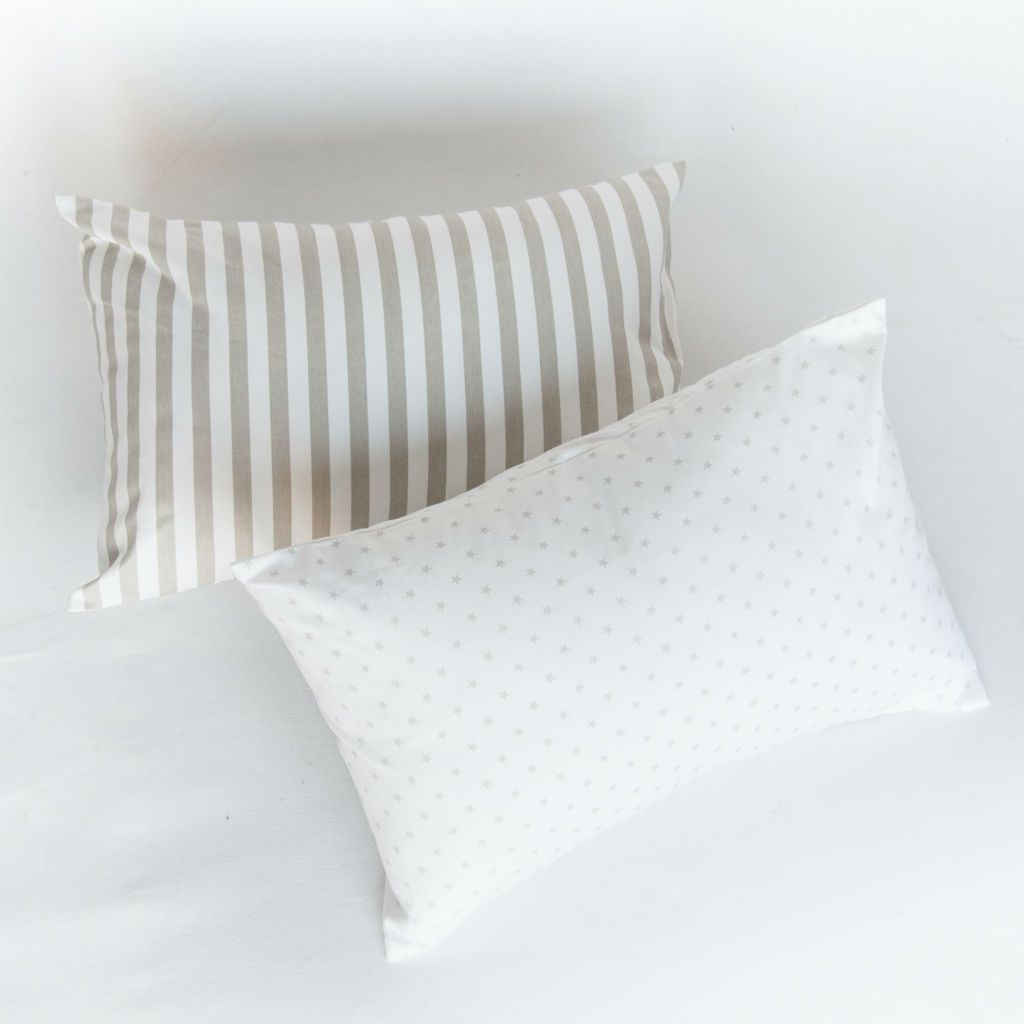 white pillow with mini star pattern and white pillow with grey stripes