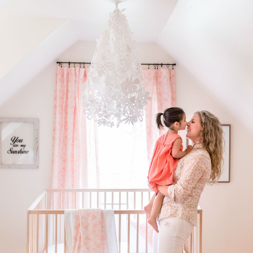 sweet toddler and mom rubbing noises in blush pink bedroom