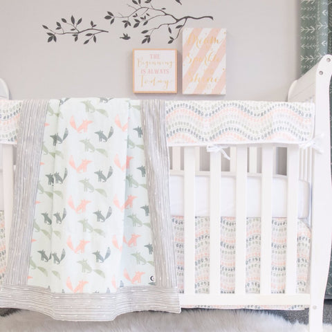 white crib with fox blanket, white crib sheet, jewel crib skirt and rail protector