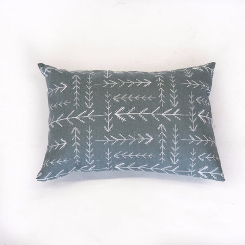 dark teal lumbar pillow with small white arrow pattern