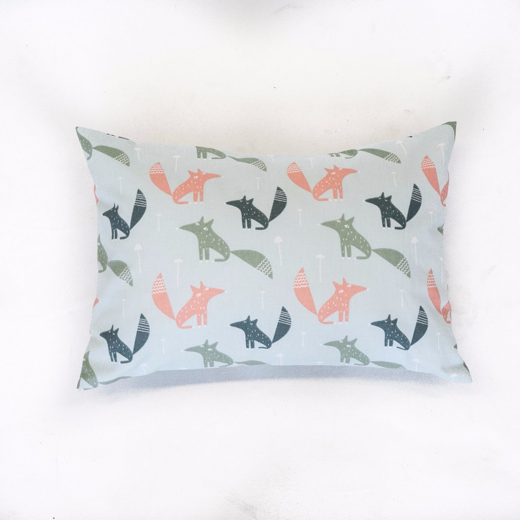 lumbar pillow with coral, dark and light green fox pattern