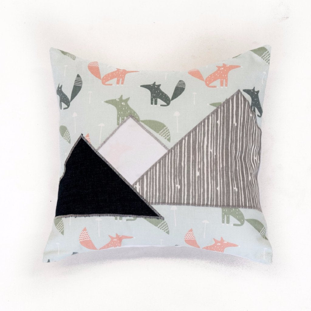 three mountains on a square pillow with coral and green fox background