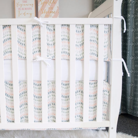 jewel bumper pads with jewel crib skirt on a white crib
