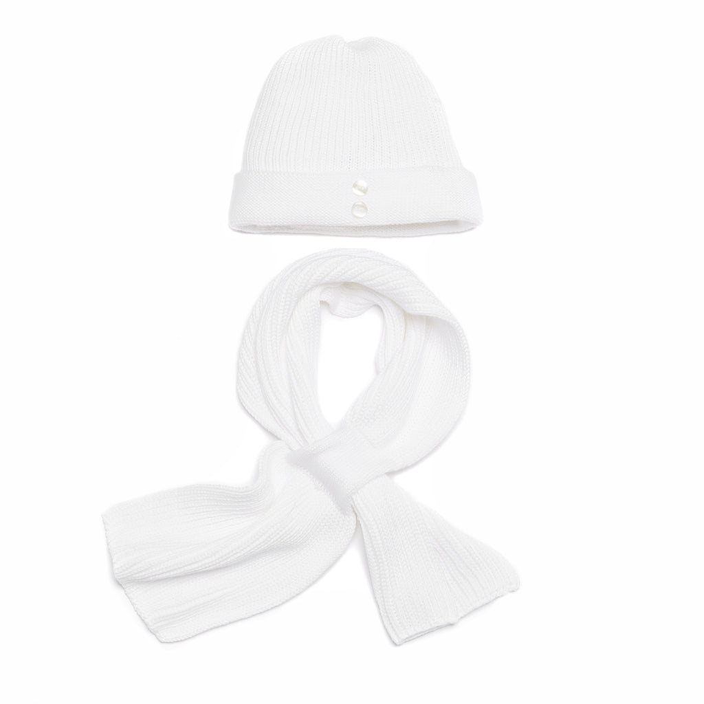 White baby hat with buttons detail