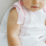 "White baby girl ""Helen"" piqué cotton dress with pink satin ribbons"