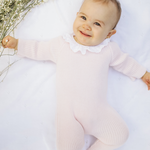 Pink knitted wool onesie
