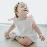 "White baby girl ""Cortito"" dress in piqué cotton with pink threading details and ribbons"