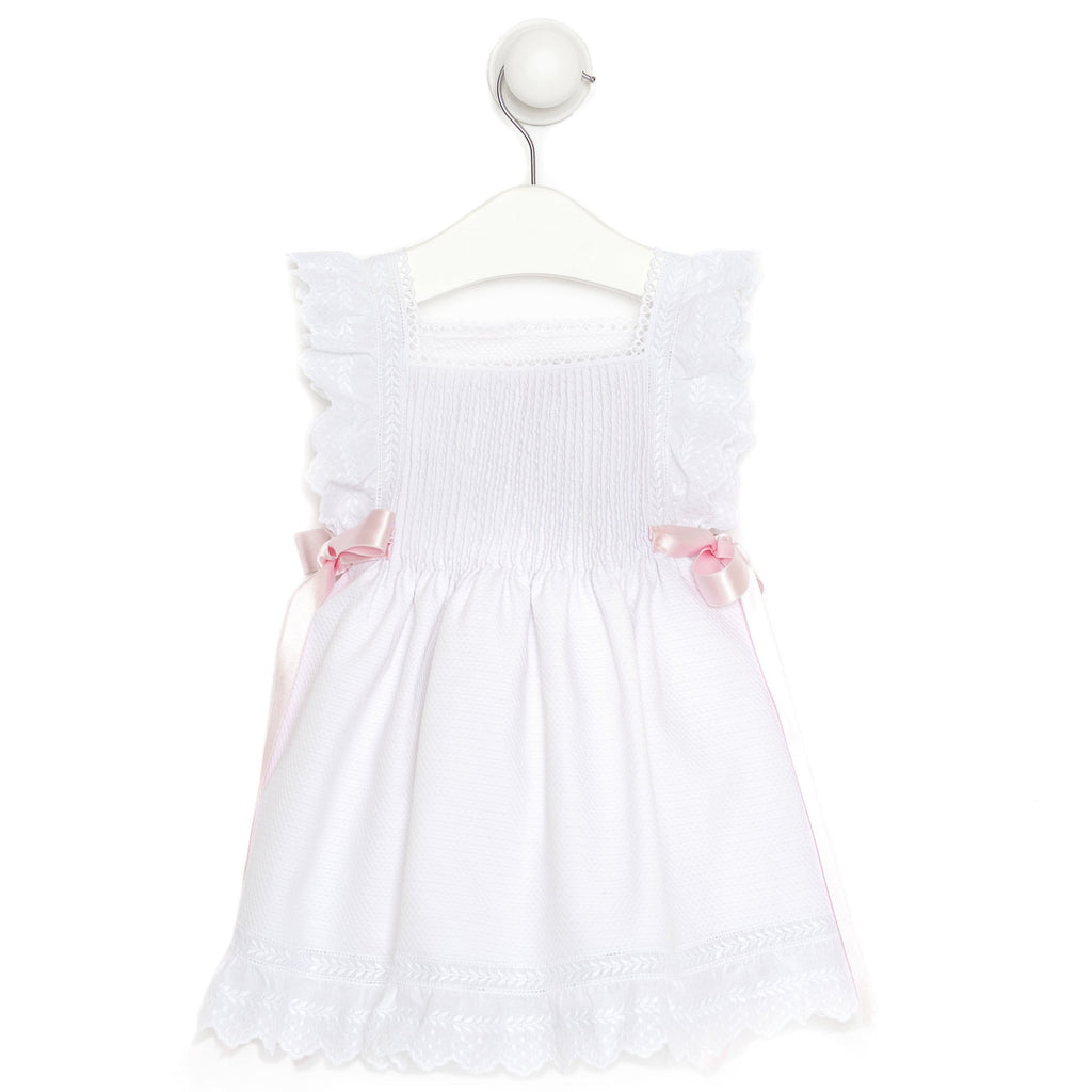"White ""Paloma"" dress with lace details and pink ribbons"