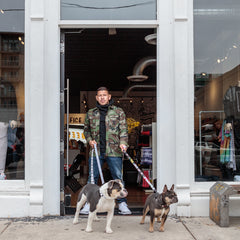NICK RIMANDO IN STORE DOORWAY WITH HIS DOGS BRUNO & OWIN.