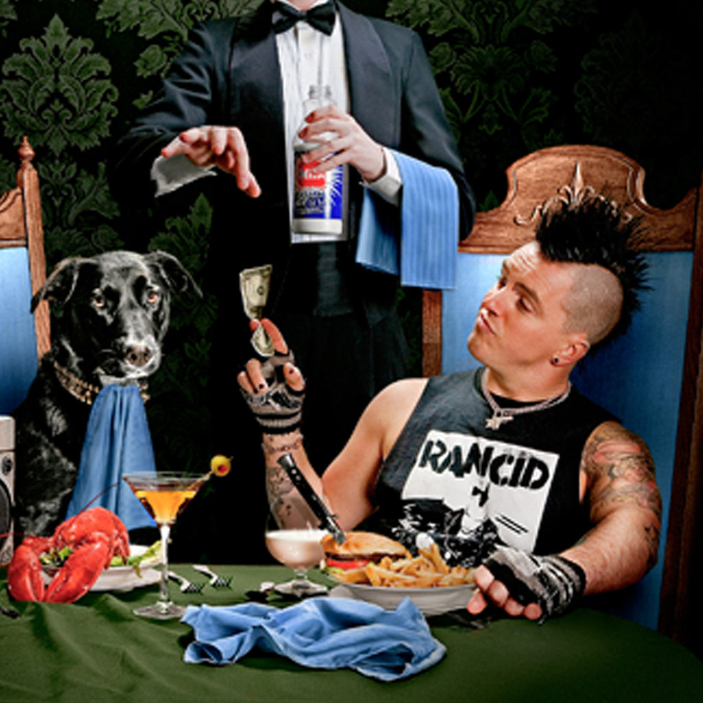 Brandon Steineckert and his dog Radio at a dinner table.