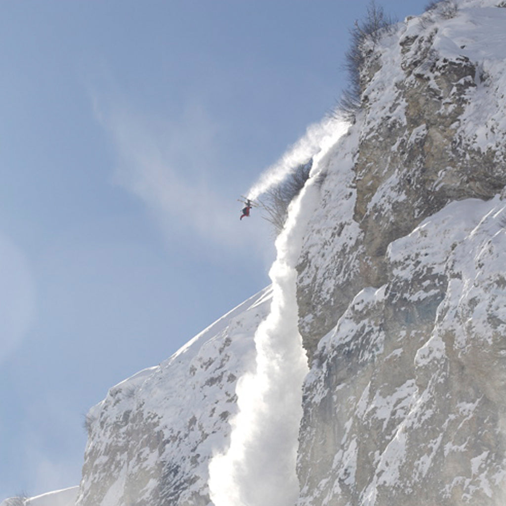 Pro skier Julian Carr jumping off a massive cliff.
