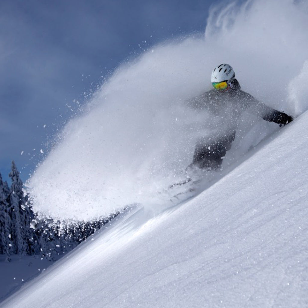 JD Platt snowboarding in deep powder.