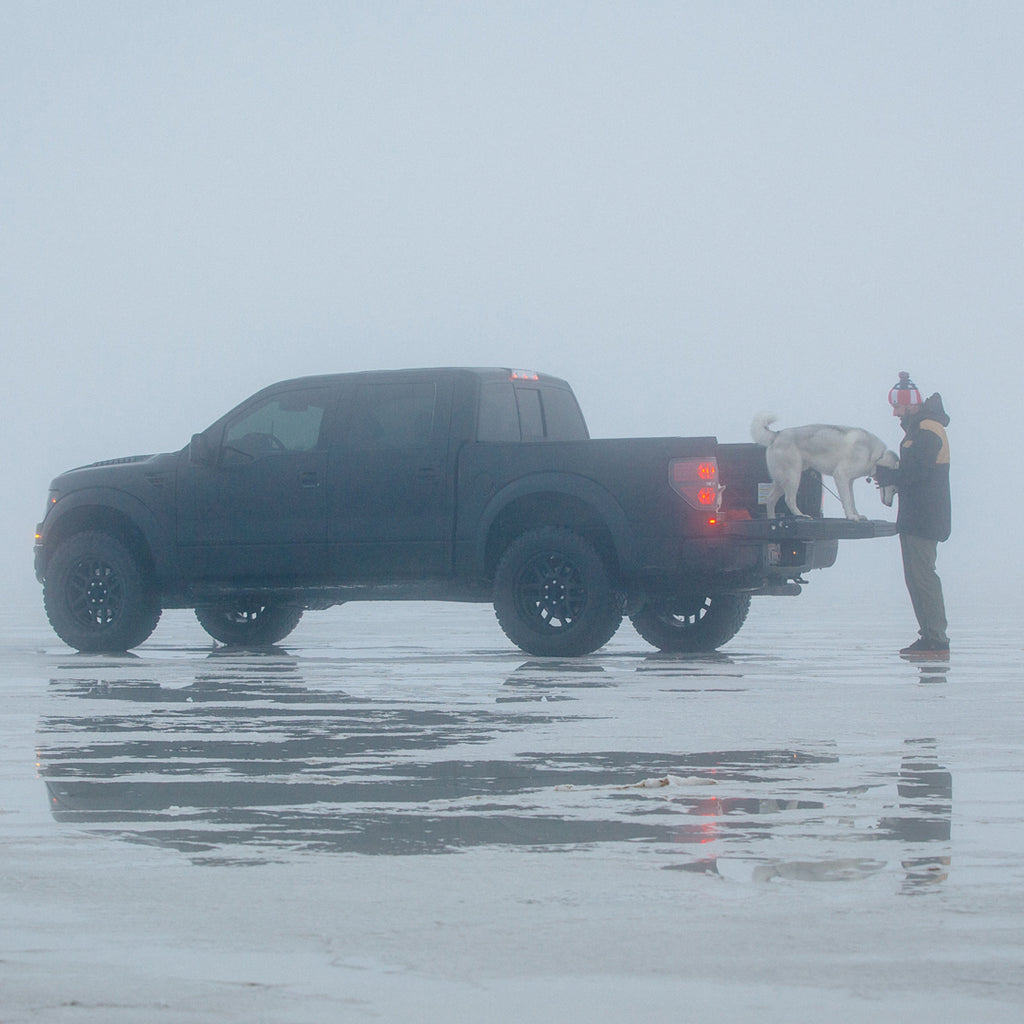Ken Block with his dog Bentley in the back of his Ford Raptor on the Great Salt Lake.