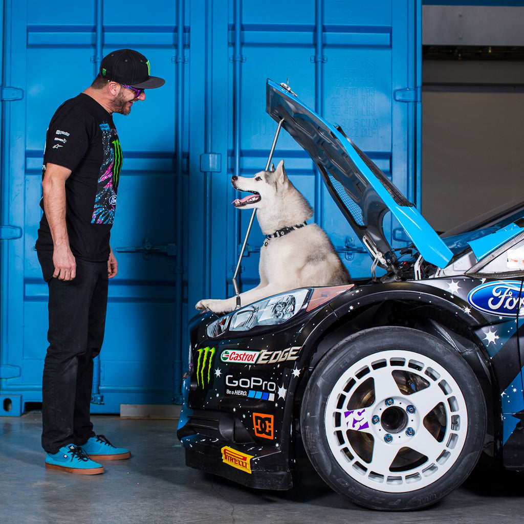 Ken Block and Bentley in the engine bay of Ken's Ford rally car.