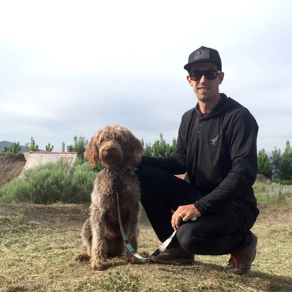 Eric Porter with his dog Juno in a field.
