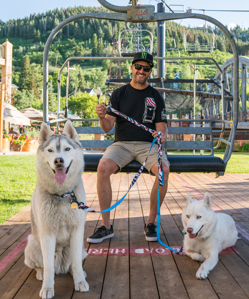 Ken Block on chairlift with his dogs Yuki and Bentley and Wolfgang leashes.