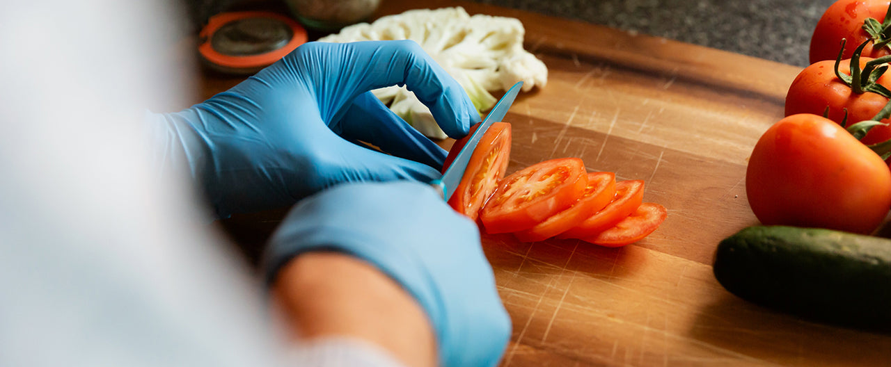 Prepping vegetables with food safety gloves