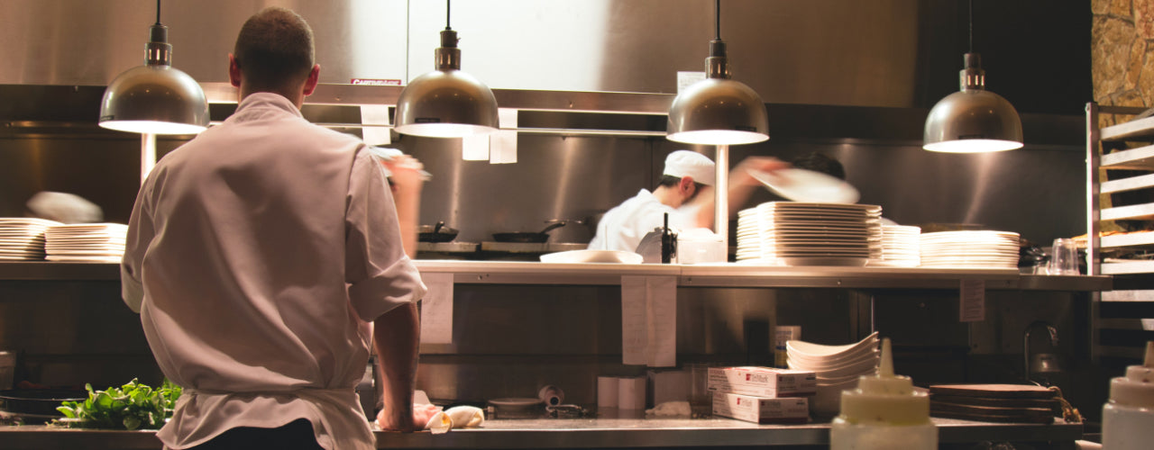 Image of cooks working in a professional kitchen