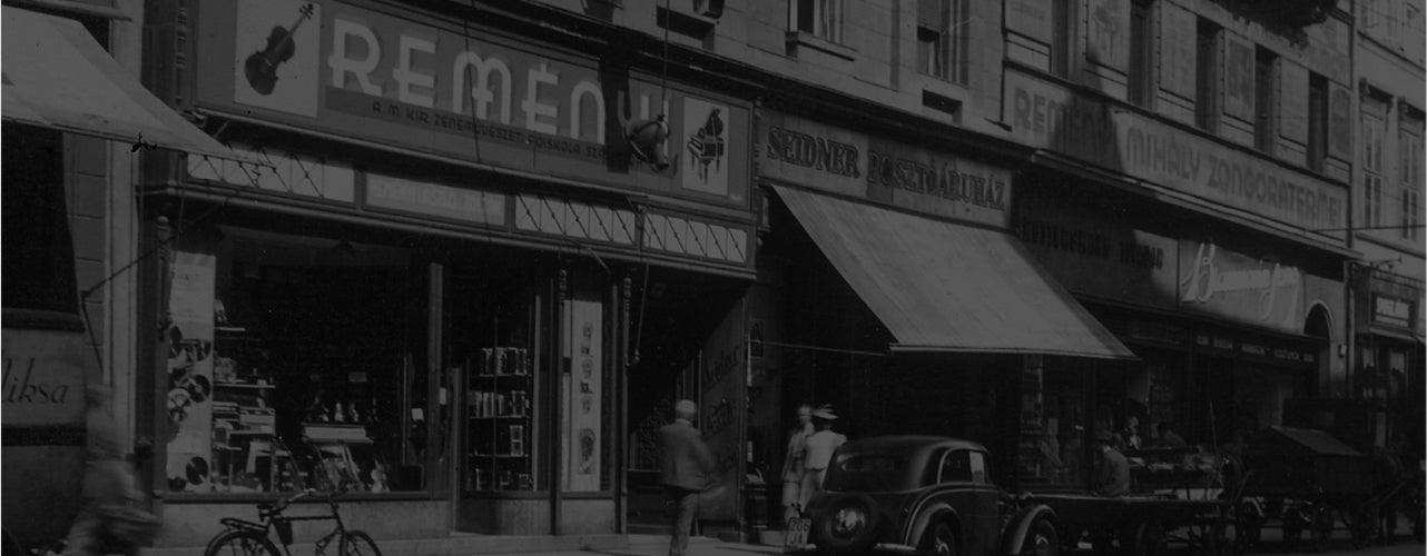 Vintage photo of people walking in front of Remenyi store in Toronto.