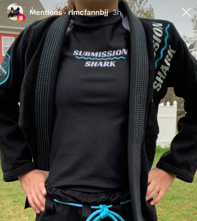 BJJ girl in a blue and black jiu jitsu gi from Submission Shark