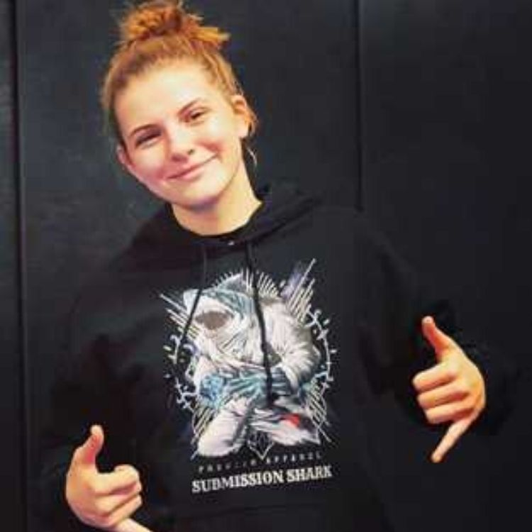 BJJ Girl Wearing a Black Submission Shark Sweatshirt at Jiu-Jitsu Practice