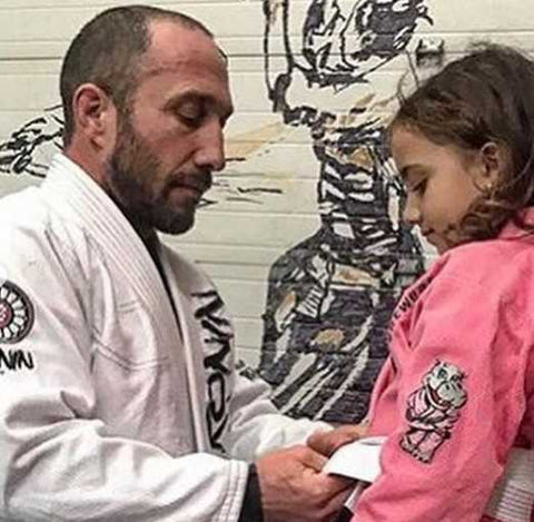 Eric Falstrault Training BJJ with Daughter in a white and pink jiu jitsu gi
