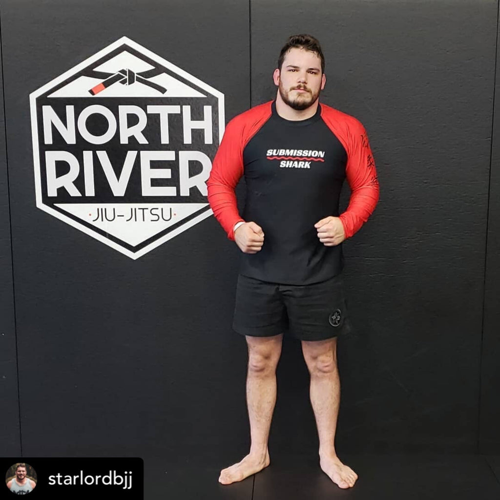 Josh Leduc at North River BJJ in a red submission shark rash guard
