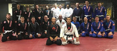BJJ Training Partners in white, blue and black gis
