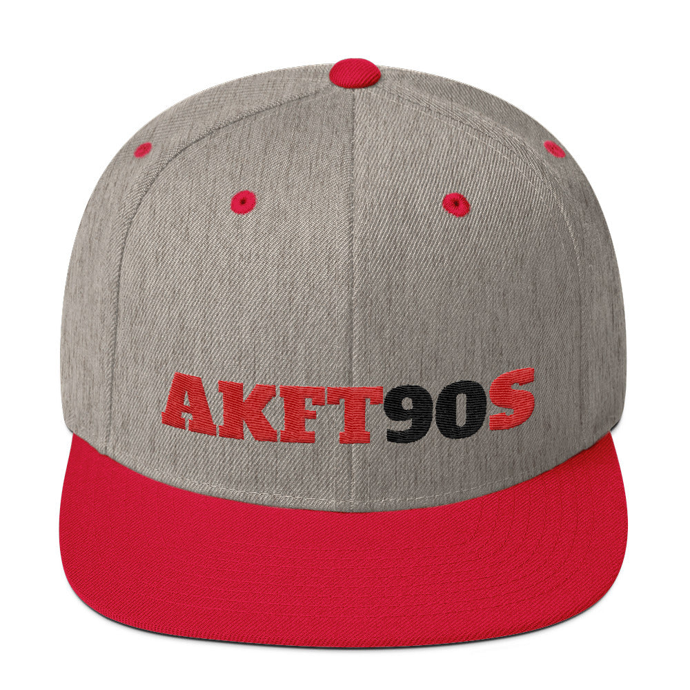 Gray, red snapback hat with red and black letters